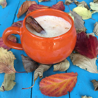 Hot cider with whipped cream on top
