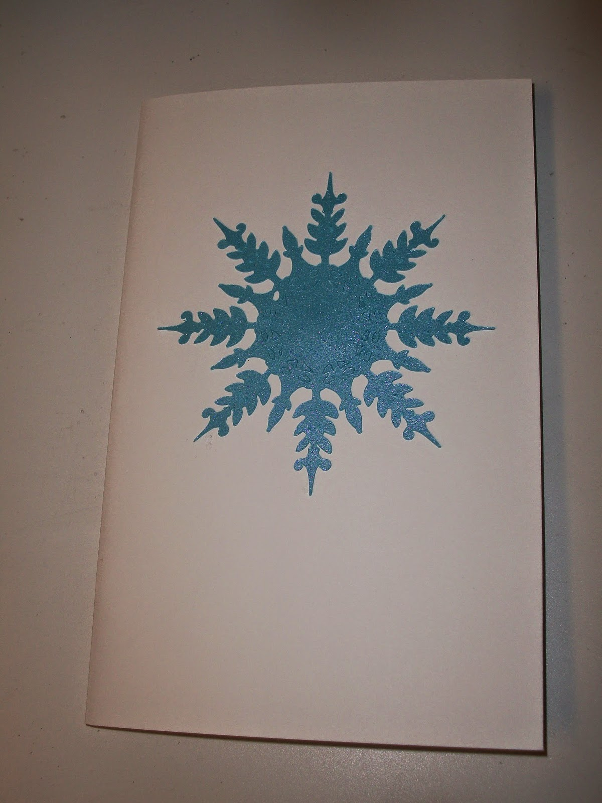 Paper snowflake shape attached to front cover of coloring book