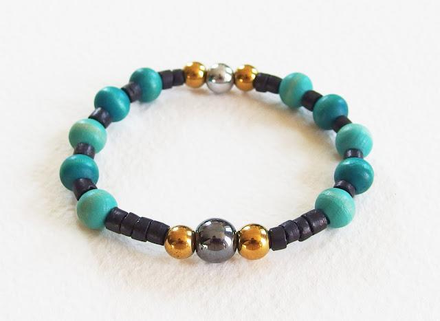 https://www.alittlemarket.com/bijoux-pour-hommes/fr_bracelet_homme_foret_d_emeraude_perles_bois_et_hematite_noir_vert_dore_anthracite_-16108674.html