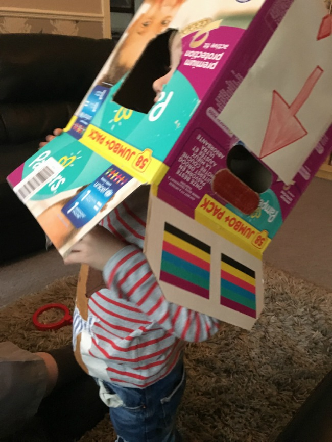 our-weekly-update-19-feb-toddler-putting-box-on-his-head