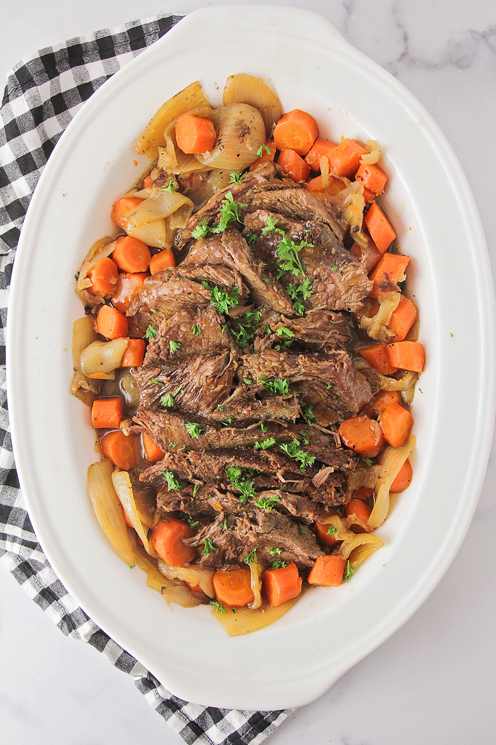 This perfect pot roast is tender, savory, and delicious, and so easy to make! It's the perfect comfort food meal!