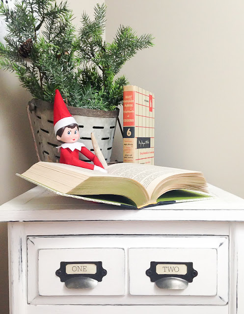 Elf on the shelf reading a book