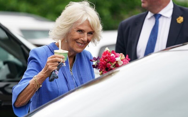 The Duchess of Cornwall visited Hay-on-Wye in Wales to celebrate the success of this year's Hay Festival. The Duchess wore a blue cafan dress