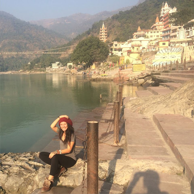 Girl outside sitting by water in Rishikesh India