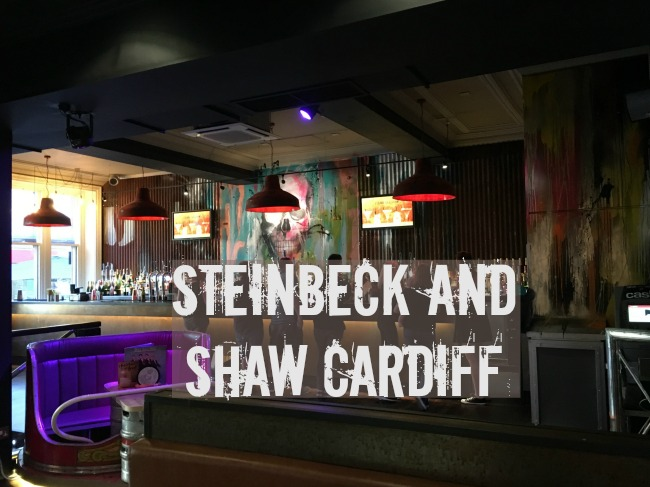 Steinbeck-and-Shaw-Cardiff-a-review-text-on-image-of-people-stood-at-the-bar