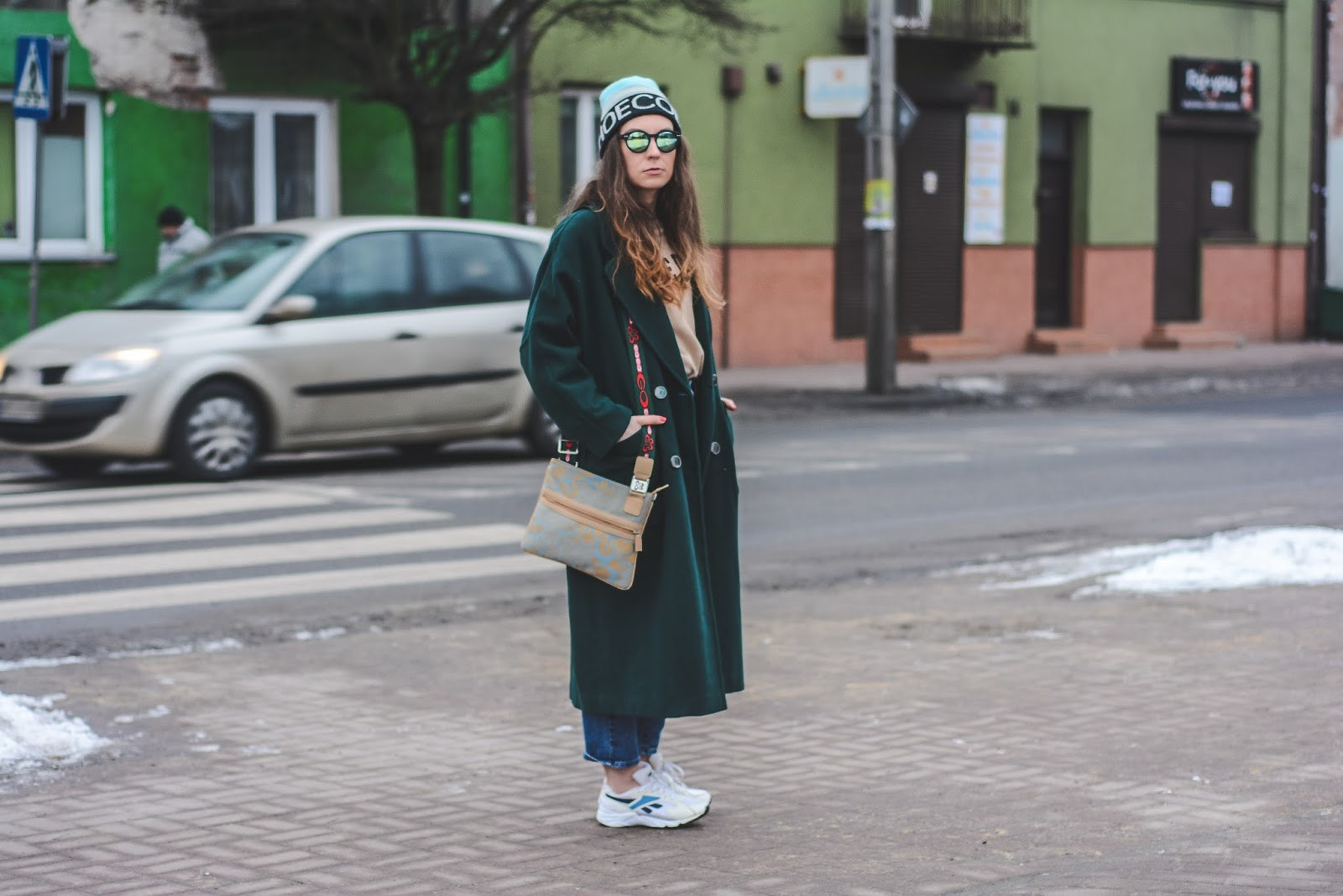 green maxi coat and mom jeans