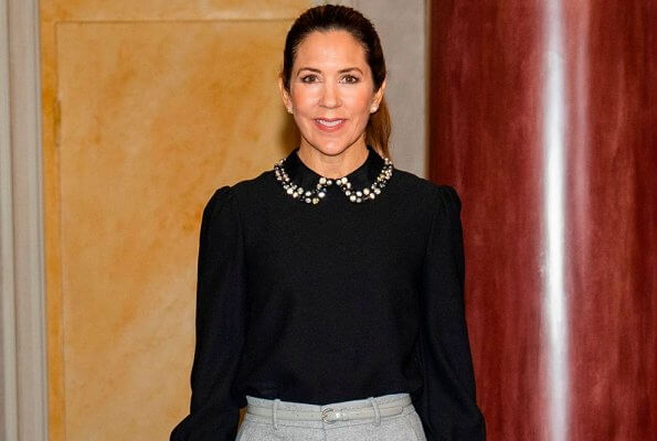 Crown Princess Mary wore a new crystal-collar crepe top from Red Valentino. Minister for Development Aid Rasmus Prehn.  UN World Food Programme