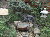 Water basin with bronze dragon fountain - Samuel Cocking Garden, Enoshima Island, Japan