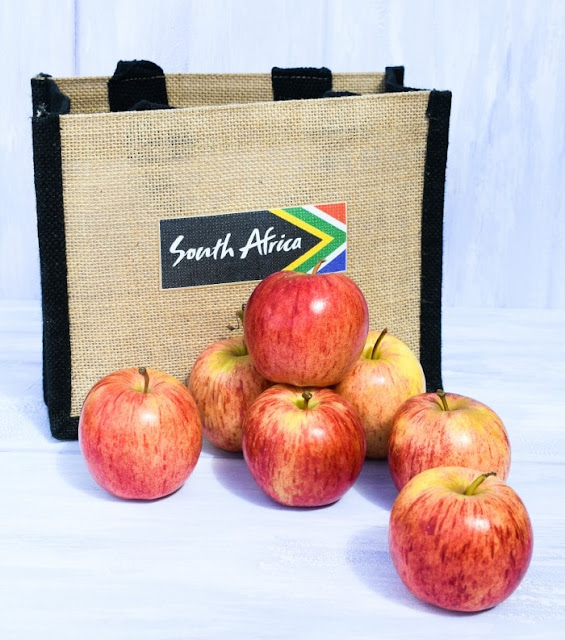 South African Red Gala Apples in front of jute bag