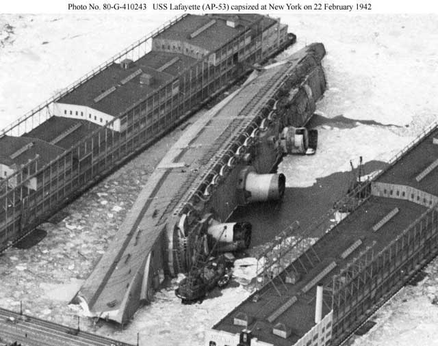 SS Normandie after it capsized on 9 February 1942, worldwartwo.filminspector.com