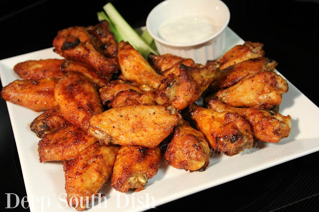 Chicken wings with a zing! Meaty chicken wings, coated with a lightly spicy rub and marinated in the fridge for an hour or up to overnight, baked and tossed with a simple, classic buttery hot sauce or a wing glaze.