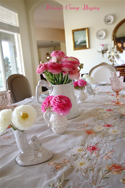 French table with fresh pink and white ranunculus