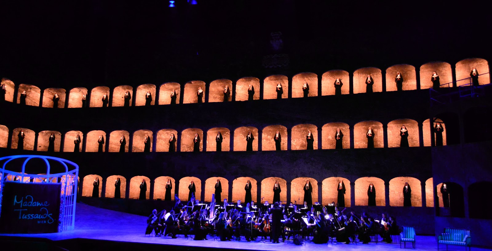 During the opening score, a candlelight procession of 50 nuns filled all three tiers of arcades.