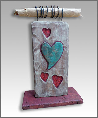 Heart side of small desktop wood sculpture