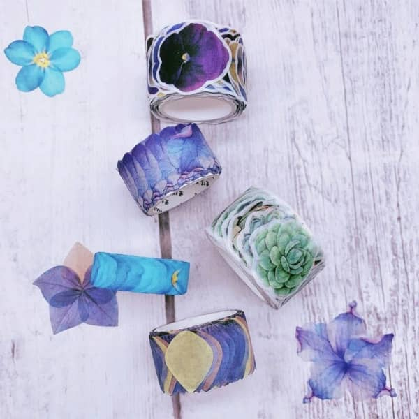 rolls of purple and green washi tape stickers