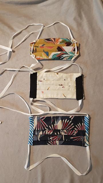 Three pleated fabric masks