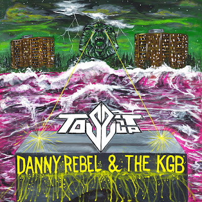The cover painting features a large statue of a lion between two apartment buildings. Lasers shoot out from its eyes across a churning river toward the title of the album.