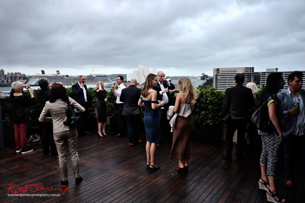 Guests on the wind swept deck at the MCA for Connect Italy 2017, Sydney, Australia. Street Fashion Sydney by Kent Johnson.
