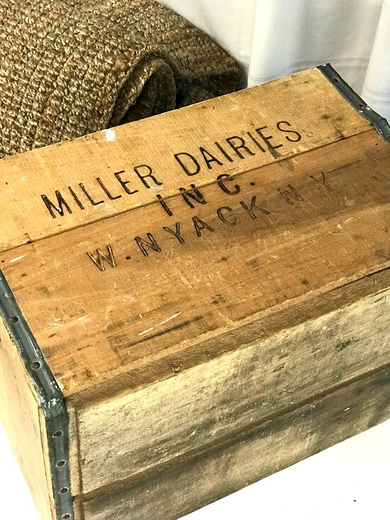 Antique crate with flag stencil