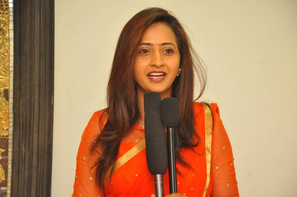 TV Anchor Lasya Stills In Yellow Dress At Movie Launch