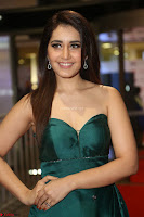 Raashi Khanna in Dark Green Sleeveless Strapless Deep neck Gown at 64th Jio Filmfare Awards South ~  Exclusive 139.JPG