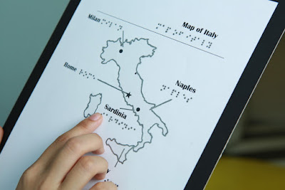 map of  italy printed with touchable ink. Shows raised image of italy with some cities printed in text and braille.