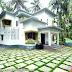 1600 sq-ft work finished flat roof Kerala home