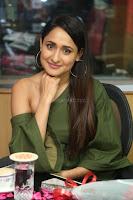 Pragya Jaiswal in a single Sleeves Off Shoulder Green Top Black Leggings promoting JJN Movie at Radio City 10.08.2017 037.JPG