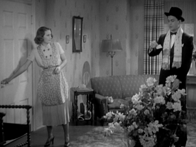 And Hugh (Robert Young) offers Carolyn (Barbara Stanwyck) huge fancy bouquets.
