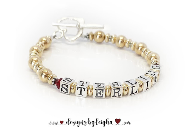 Sterling Bracelet with Ruby Birthstones and a Heart Toggle Clasp