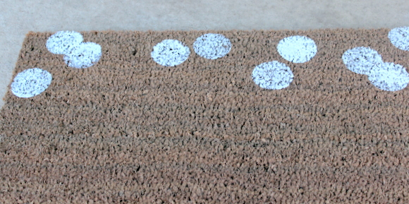 Start making polka dots on your rug! Here are the first layer of white dots.