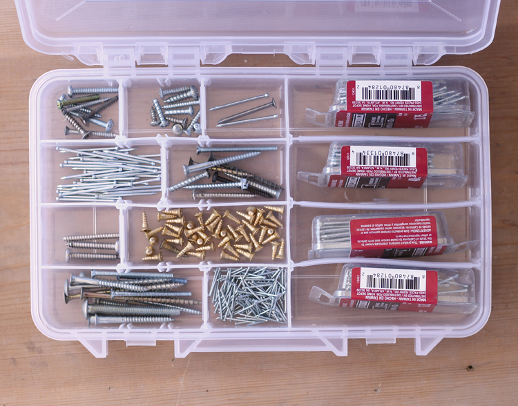 Use a divided craft tray to sort screws and nails in the garage.