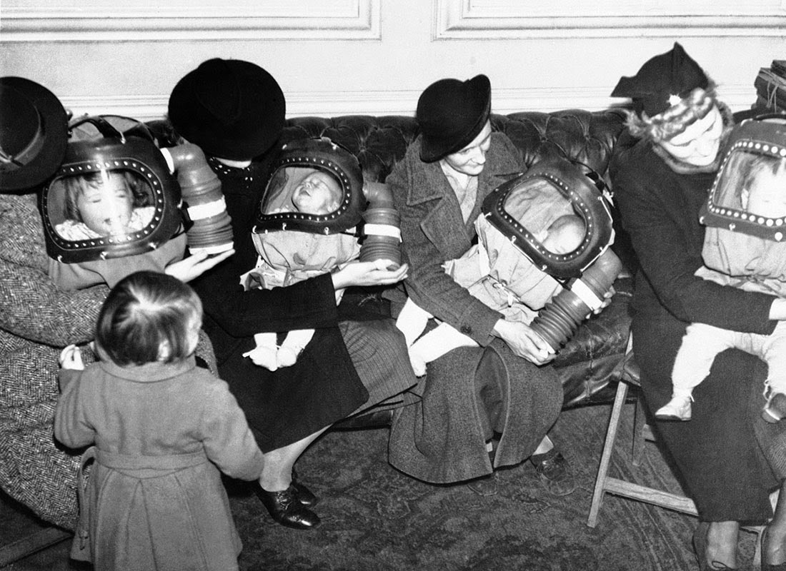 "Mothers outfitting their children with ""baby helmets""."