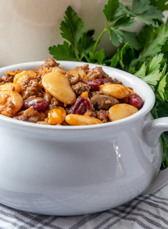 These Calico Beans are made with ground beef, bacon, bell pepper and three kinds of beans. It is the ultimate comfort food dinner main dish or side dish! Perfect for summer BBQ's or Sunday dinner in the winter time!