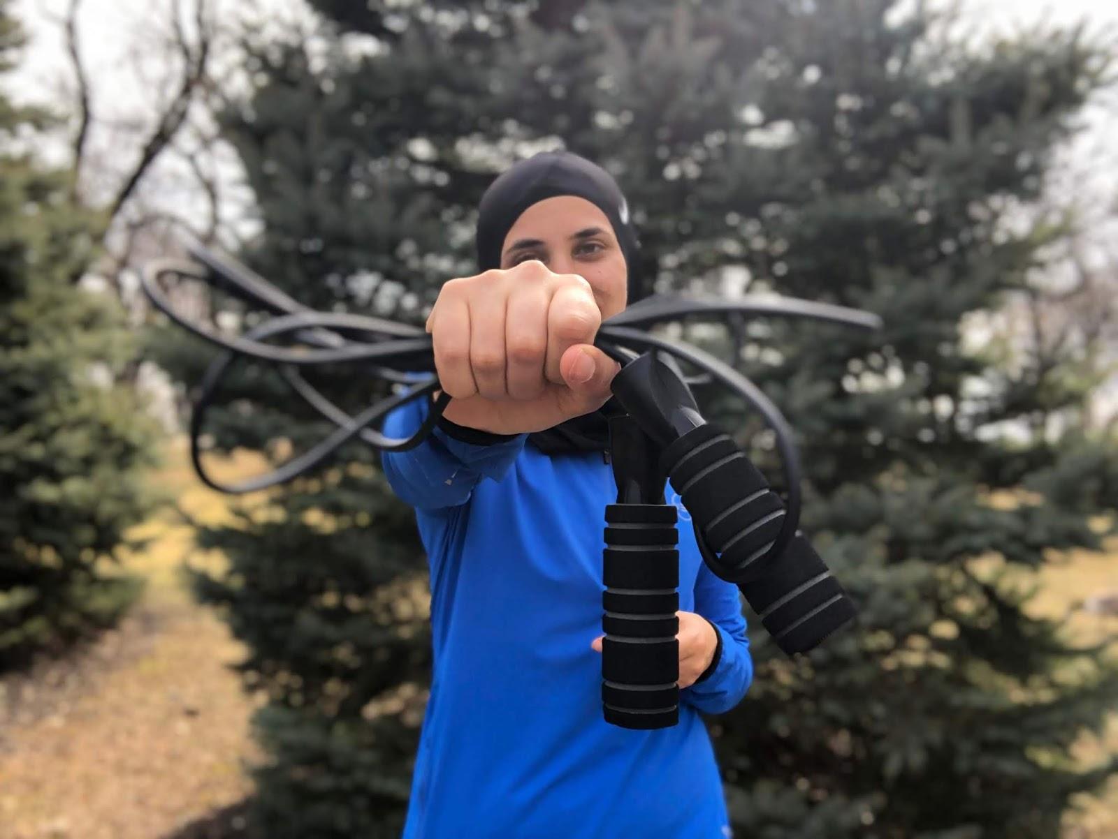 Runner holding jump rope