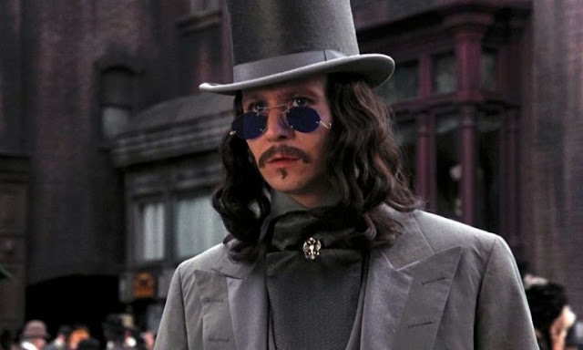 Gary Oldman wearing a top hat and grey suit as Count Dracula