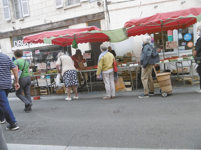 Shoppers at the market in Loches. Indre et Loire. France. Photo by Loire Valley Time Travel.
