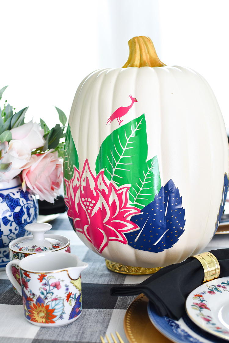 A DIY chinoiserie tobacco leaf pumpkin vinyl project for Cricut or Silhouette. | #fallcrafts #falldecorideas #cricutexplore #silhouettecameo #pumpkindecor #monicawantsit
