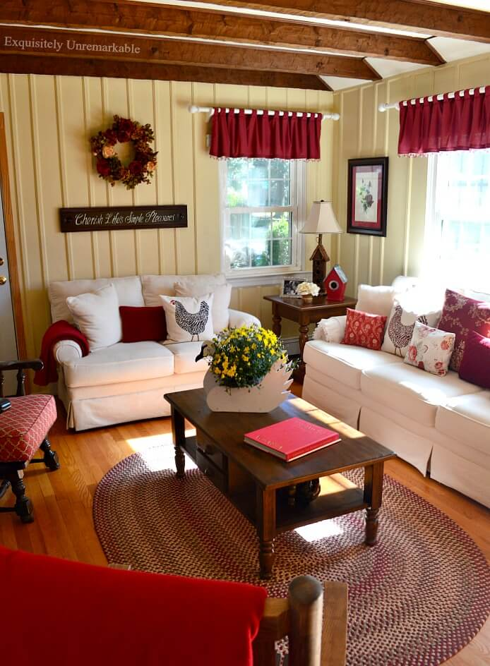 Rustic Cottage Living Room with white couches and red accents