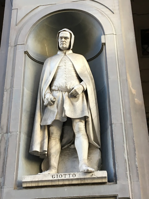 Statue of Giotto by Giovanni Dupré outside the Uffizi Gallery in Florence
