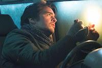 Car interior, man in jacket