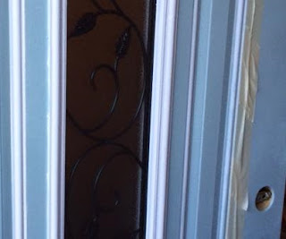 Using tape to mark paint lines for trim work on door