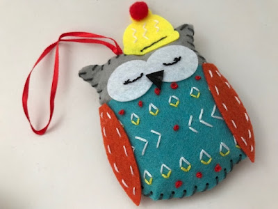 Festive felt owl made using a craft kit