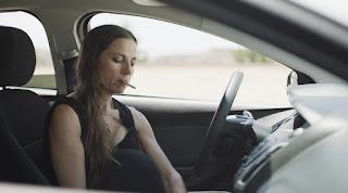Justine Bateman sitting inside the car