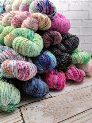 pyramid of yarn on wooden background