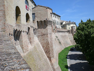 Iesi has massive 14th century walls that reflect its history as a former stronghold of the Sforza family