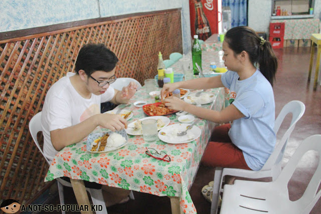 Emil Ong and Betty feasting on the shrimps