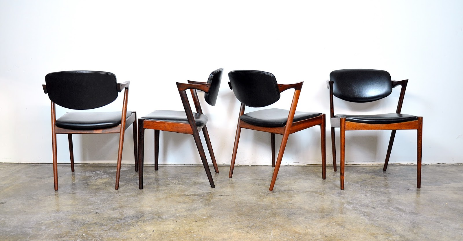 Select Modern Set Of Four Kai Kristiansen Model 42 Rosewood Dining Chairs