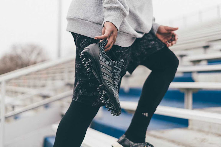83e91af9292 ... Triple Black Adidas Ultra Boost football boots have a one-piece upper  with a melange print. Both the heel counter and lateral cage of the Ultra  Boost ...