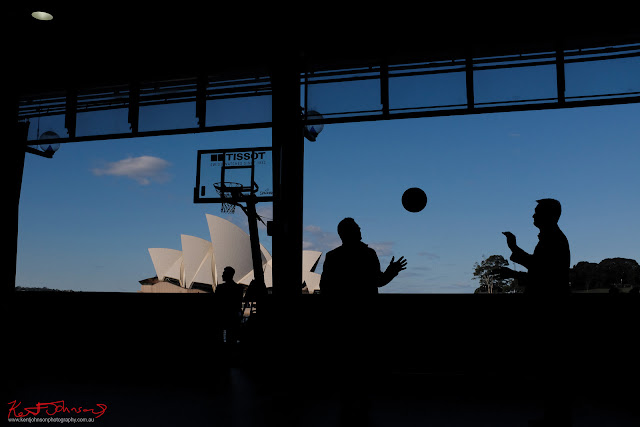 Basketball and the Sydney Opera House in silhouette. TISSOT NBA Finals Party Sydney - Photography by Kent Johnson.